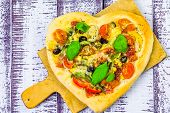 picture of olive shaped  - Pizza in the shape of a heart on a wooden background - JPG