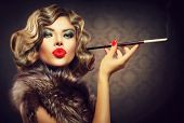 Beauty Retro Woman with Mouthpiece. Vintage Styled Beautiful Lady with cigarette. Smoking Model Girl