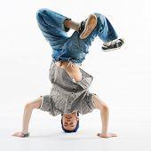 Modern dancer standing on one hand