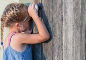 child looks at the door.