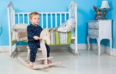 picture of pony  - Child play with a wooden Rocking Toy horse pony - JPG