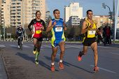 VALENCIA, SPAIN - JANUARY 12, 2014: Runners compete in the 10K Divina Pastora Valencia run. Over 10,