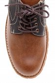 top of brown leather shoe