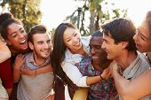 picture of hispanic  - Group Of Friends Having Fun Together Outdoors - JPG