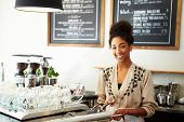 stock photo of cash register  - Male And Female Staff In Coffee Shop - JPG