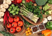 stock photo of wooden basket  - fresh vegetables on wooden table - JPG