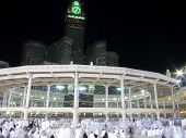 Kaaba the Holy mosque in Mecca with Muslim people pilgrims of Hajj praying in crowd (newest and very