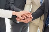 Extreme close-up of a business team joining hands together