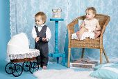 cute children with baby carriage