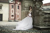 bride in a white dress on the street