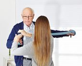 Senior man at physiotherapy in a nursing home