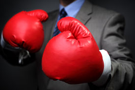 picture of knockout  - Tough competitive business concept businessman wearing boxing gloves - JPG