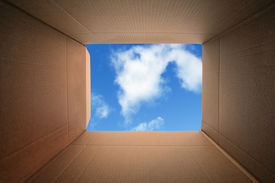 stock photo of thinking outside box  - Inside a cardboard box concept for moving house - JPG