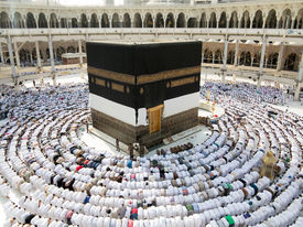 stock photo of kaaba  - Kaaba the Holy mosque in Mecca with Muslim people pilgrims of Hajj praying in crowd  - JPG