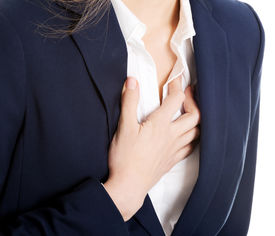 picture of breast-stroke  - Beautiful business woman touching her chest - JPG