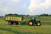 John Deere 6210R Tractor And Full Krone Mx 350 Gl Forage And Discharge Wagon