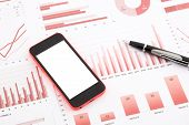 Blank Mobile Phone  On Red Graphs, Charts , Data And Business Report Summarizing Background