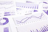 stock photo of 100 percent  - purple graphs charts data and report summarizing for marketing research management budget and planning business project