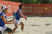 MOSCOW, RUSSIA - JULY 19, 2014: Man double of Japan in the match against Germany during ITF Beach Tennis World Team Championship. Japan won this rubber, but German won the match