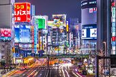 TOKYO, JAPAN - MARCH 19, 2014: Shinjuku district illuminated at night. The district is a renown nigh