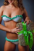 Girl In A Bikini With Holiday Gift