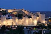 Avila Illuminated At Dusk. Spain