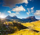 Mountains glow by morning sunlight in the national park Durmitor in Montenegro, Balkans. Europe. Bea