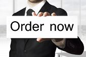 Businessman Holding Sign Order Now
