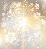 Golden background with snowflakes. Copy space
