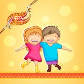 Cute little sister and brother hugging to each other on occasion of Raksha Bandhan celebrations with beautiful rakhi on bright yellow background.