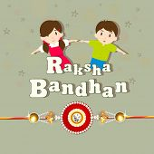Cute little sister and brother holding their hands with beautiful rakhi on green background for Raks