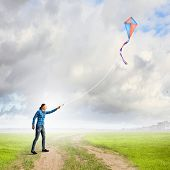 Young woman in casual playing with colorful kite