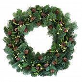 Christmas green spruce fir wreath with mistletoe and pine cones over white background.