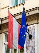 the european union (eu) flag and the austrian flag.