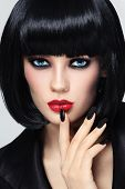 Young beautiful sexy woman with stylish bob haircut and black manicure