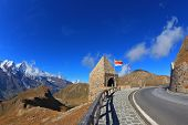 Picturesque alpine road Grossglocknershtrasse. Bright sunny day. Photo taken by lens Fisheye
