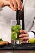 stock photo of bartender  - Barman preparing cocktail - JPG