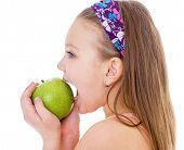Charming little girl with green apple.