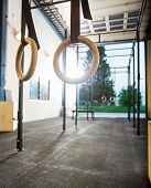 Gymnastic rings hanging at cross fitness box