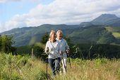 Senior people hiking in beautiful natural landscape