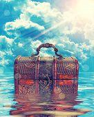Treasure Chest In Water Agaist Cloudy Sky