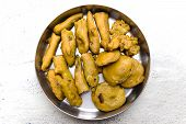 Indian evening snack / savoury made from chilly & brinjal dipped on gram flour dough and fried
