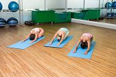 Yoga class in childs pose in fitness studio at the leisure center