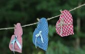 Three country hearts hanging on clothesline outdoors