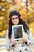 Woman Holding Digital Tablet In Autumn