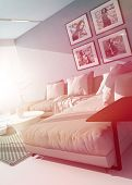 Bright hot living room interior bathed in a shaft of sunlight on a comfortable modern upholstered lounge suite and wall mounted pictures