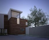 Modern contemporary house facade with an exterior courtyard and tree in evening light with vignettin