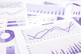picture of budget  - purple graphs charts data and report summarizing for marketing research management budget and planning business project