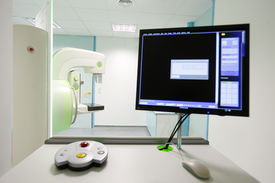 stock photo of mammography  - Mammography breast screening device in hospital laboratory with computer display in foreground - JPG