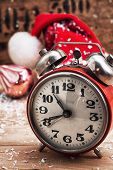 Old-fashioned Alarm Clock And Red Christmas Cap